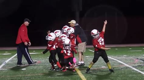 Mighty Mite football players 'Whip/Nae Nae' in the middle